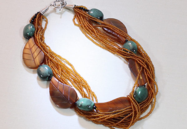 Necklace amber horn seeds & viridian porcelain