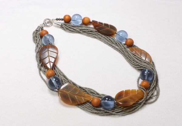 Necklace horn leaf blue glass & grey seeds