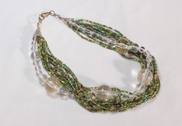 Necklace - clear/gold acrylic & green seeds