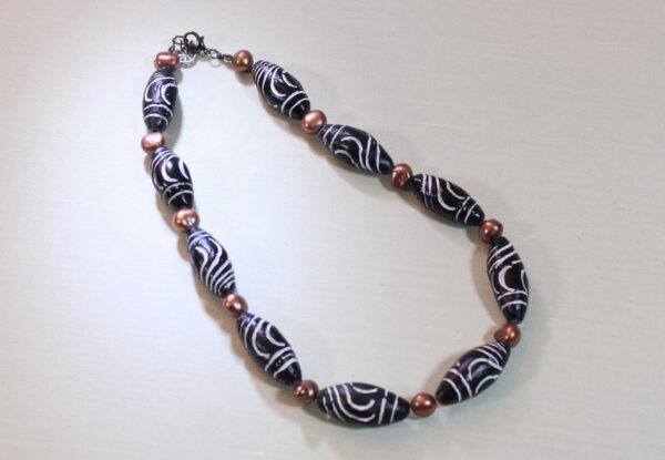 Necklace - carved black clay & orange pearls
