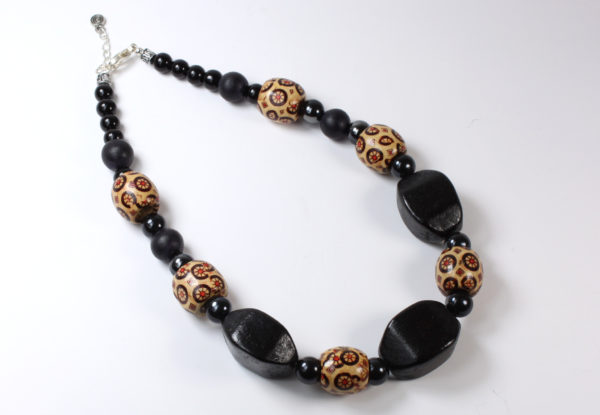 Necklace + bracelet, printed & black-painted wood