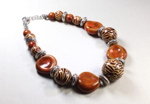 Necklace with flat orange porcelain & zebra painted wood