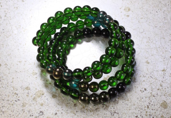 Bracelet - emerald green & black glass beads