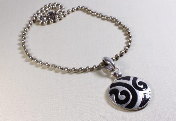 Vintage large round silver & black pendant